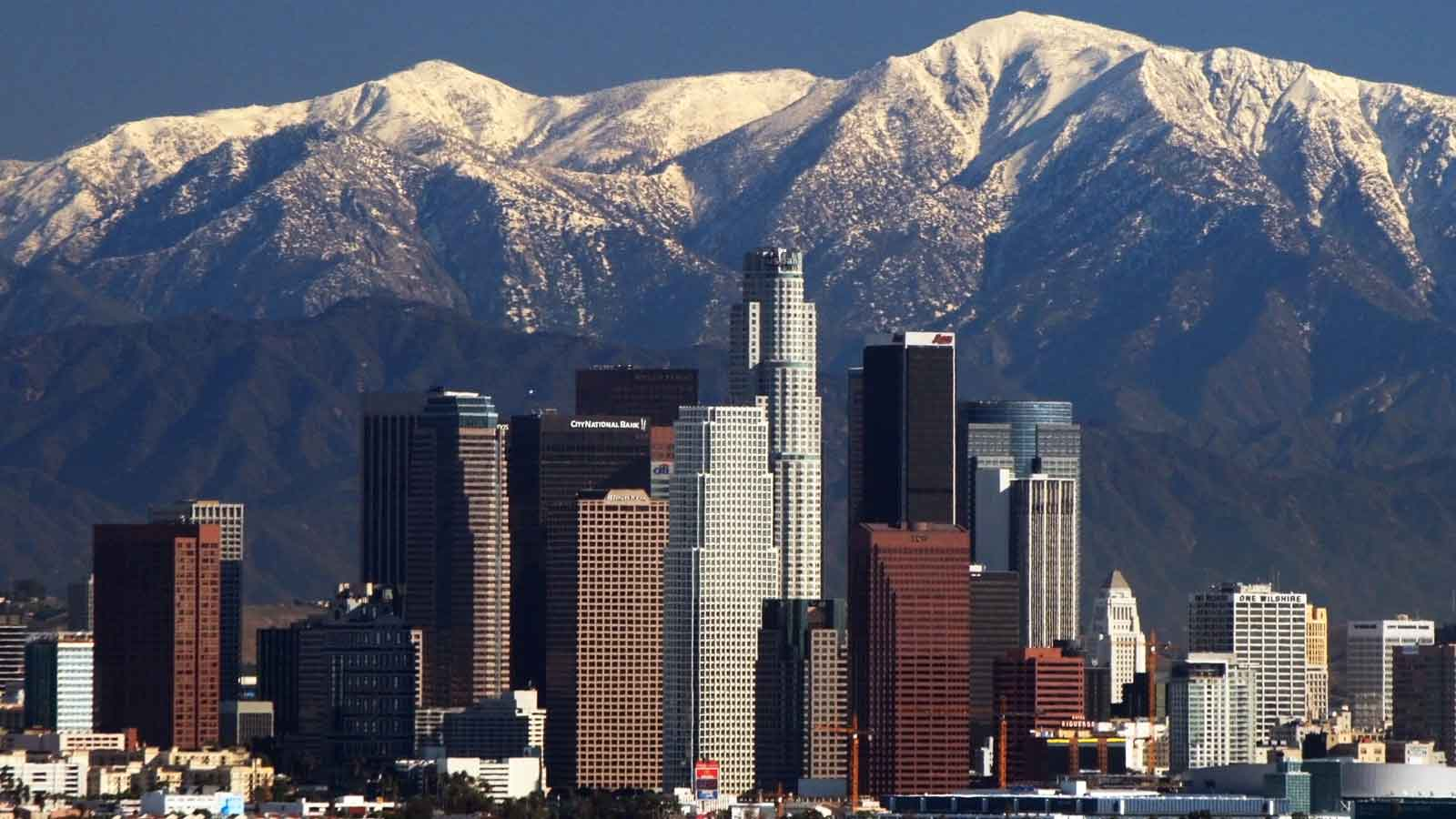 los angeles skyline with white cap mountains