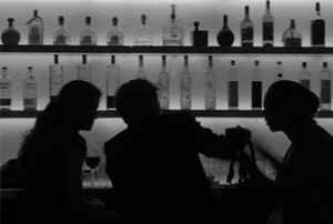 people sitting at a bar greyscale