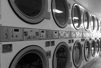 inside of a laundromat showing washing machines