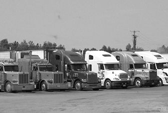 semi-trucks lined up at a truck stop