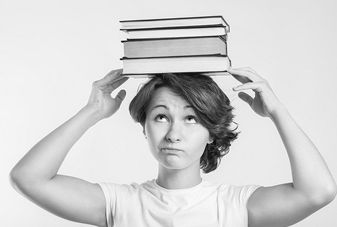 girl with books at a college