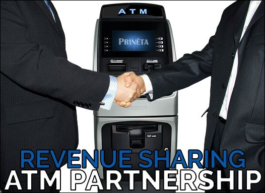 two businessmen handshake in front of ATM machine