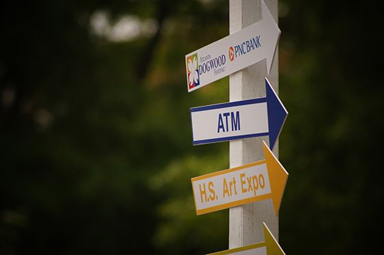 ATM machine arrow sign at outdoor festival