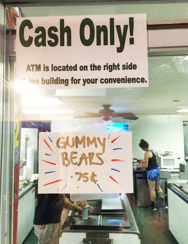 Cash Only ATM Located Inside of Store Sign in Storefront Window