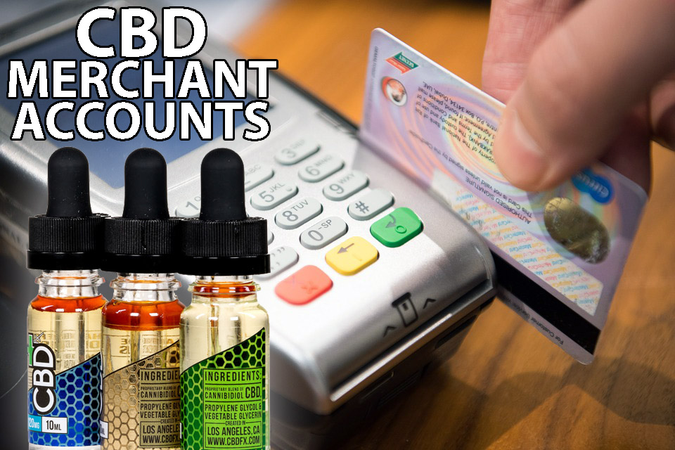 Credit card processor next to cbd oil containers
